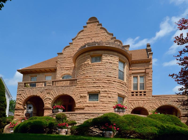 Stone Fortress. This is a Summer picture of a large stone house located in Fort Madison, Iowa. The house was built in 1895 and is an example a combination of stock photography