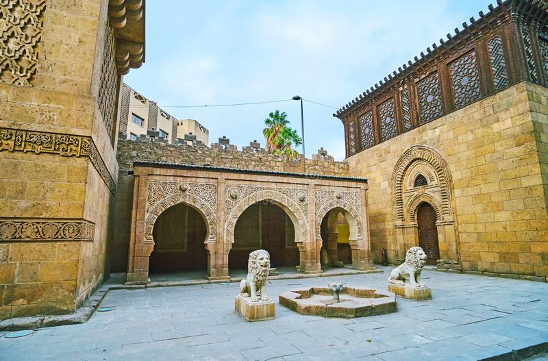 The fountain at the Manial Palace mosque, Cairo, Egypt. The stone fountain with lions at the beautiful carved pavilion of the Manial Palace mosque, Cairo, Egypt stock images