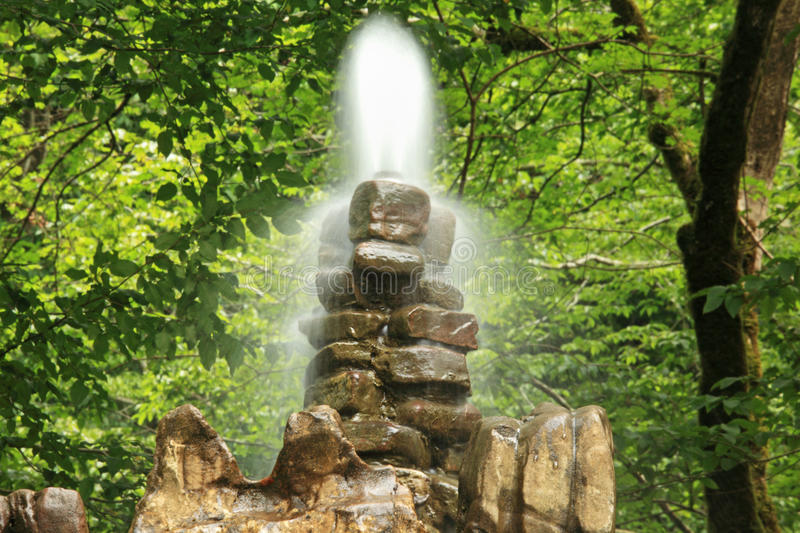 Stone fountain in wood stock photo