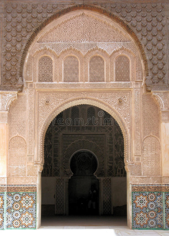 Stone fretwork arch. In Moroccan mosque stock images