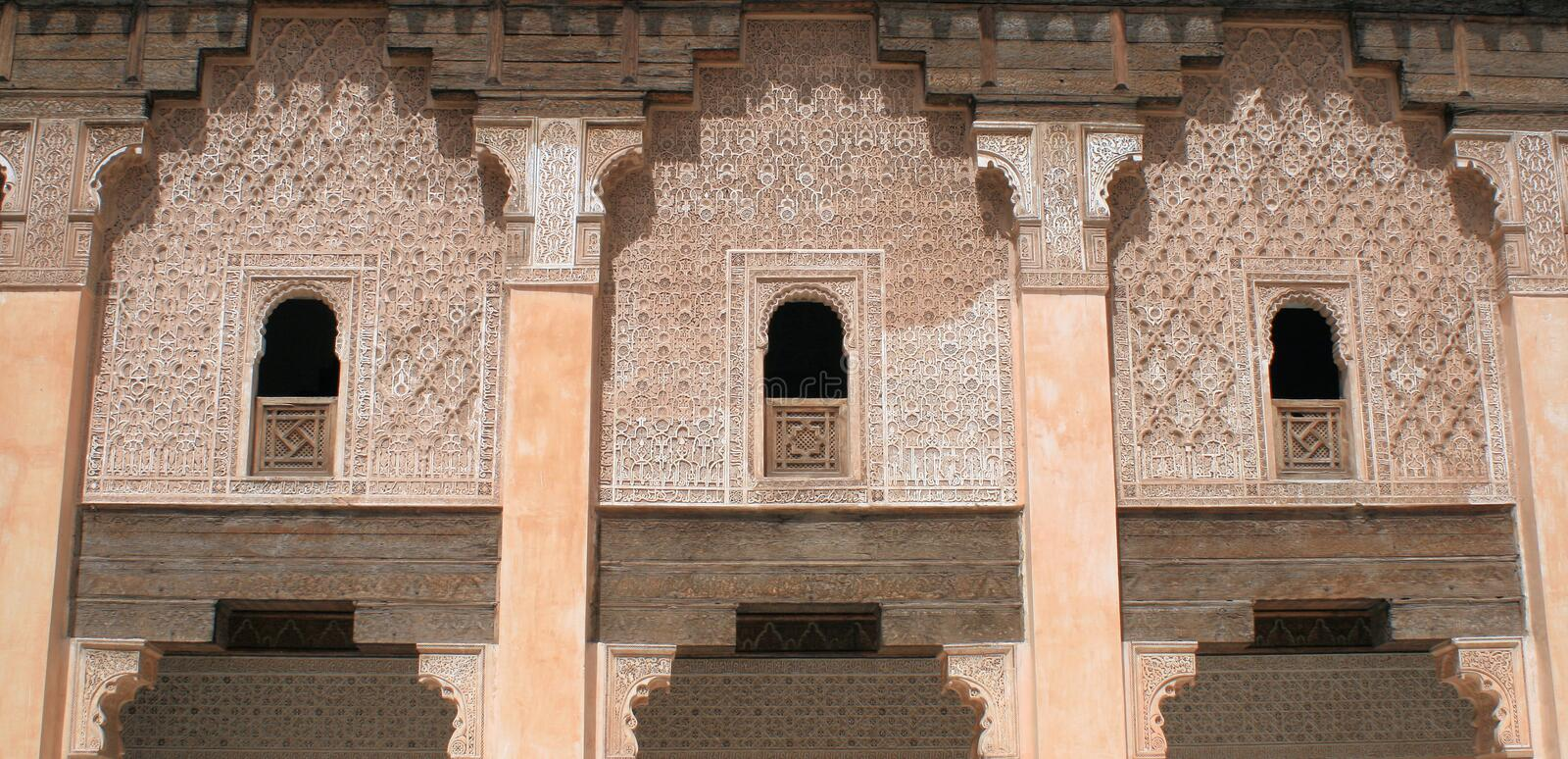 Stone fretwork wall 2. Stone fretwork wall in Morocco royalty free stock photography