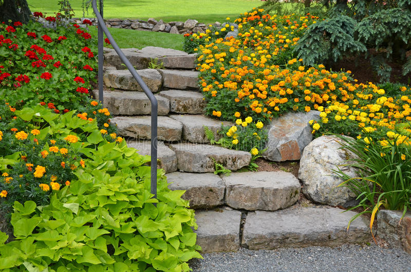 Stone garden staircase. With beautiful summer flowers royalty free stock photo