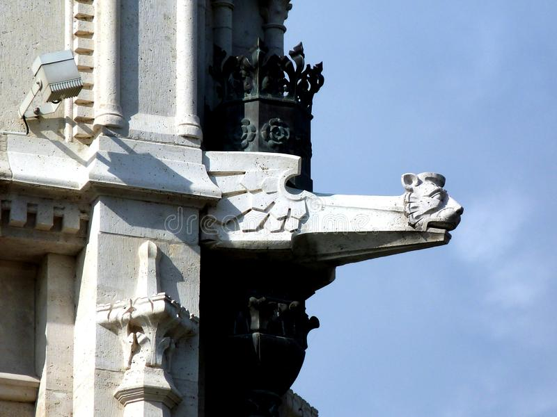Stone gargoyle and exterior detail of the Hungarian Parliament. Finely carved white stone gargoyle and exterior detail of the historical Hungarian Parliament stock photo