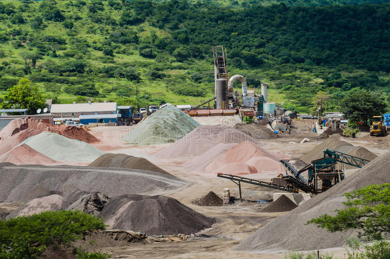Stone Grading Quarry Production. Stone quarry production plant at Shongweni valley in KZ Natal state province in South Africa. Open cast rock and conveyor belts royalty free stock photo