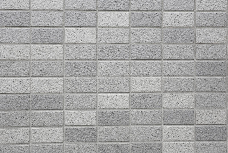 Stone granite pieces of tiles wall. Stone granite pieces of tiles wall for the design background royalty free stock image