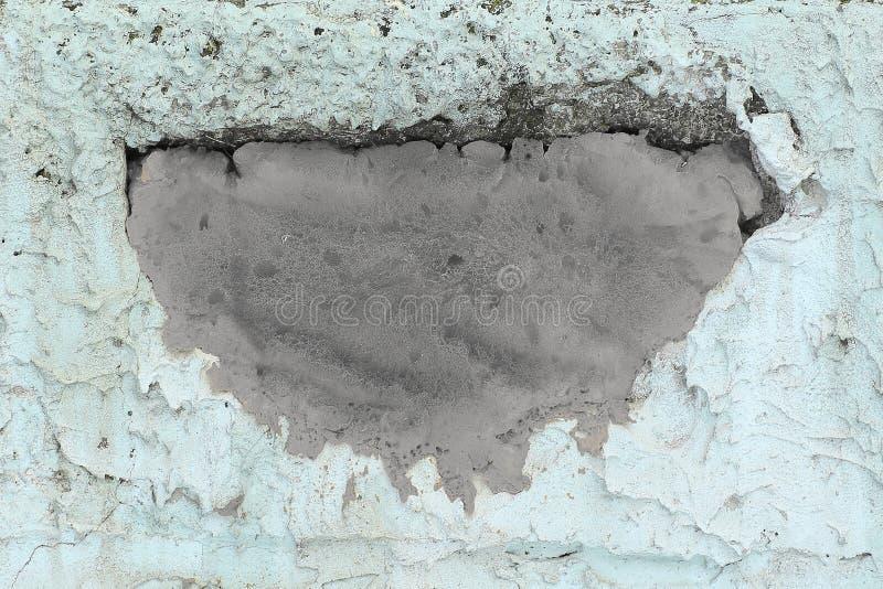 Stone grunge odd wall with hole. Abstract strange background stock image