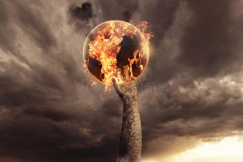 Stone hand holding burning earth and rise up in the apocalyptic sky.  royalty free stock image