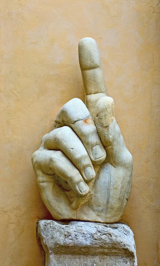 Stone hand showing direction royalty free stock photos