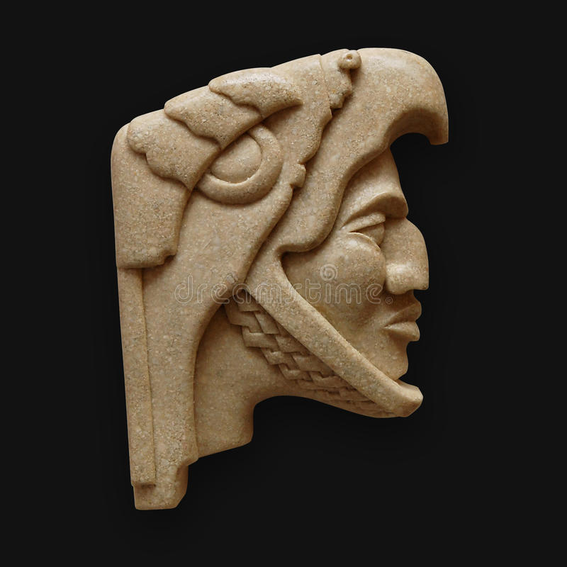 Stone head of warrior carving latin america stock image