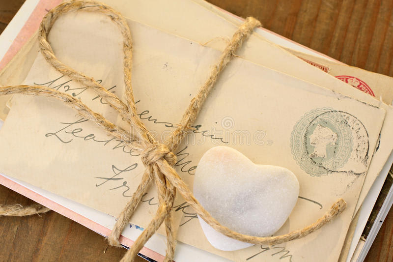 Stone heart with tied letters royalty free stock images