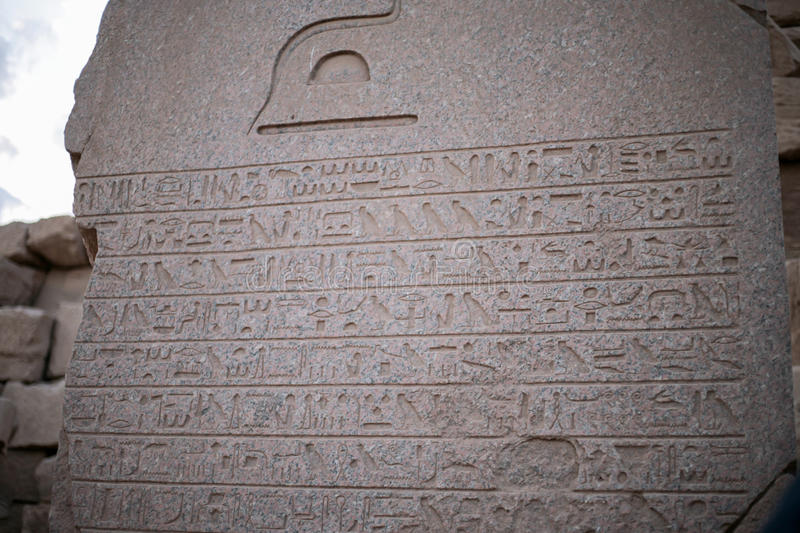 Stone Hieroglyph Tablet. Ancient egyptian stone tablet showing detailed hieroglyphs that survived through the action of time and nature royalty free stock image