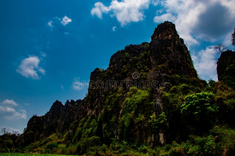 Stone hill and beautiful blue sky background, local landscape at Banmung, Neonmaprang, Pitsanulok, north of thailand. stock photo