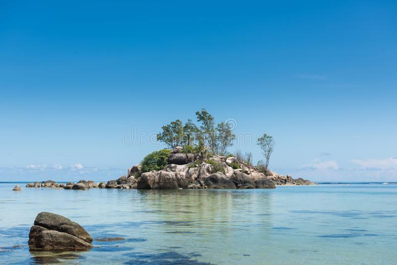 Stone hill mini island at indian ocean royalty free stock photography