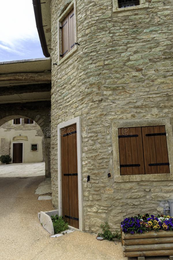 Stone house in the mountain italian houses stock image
