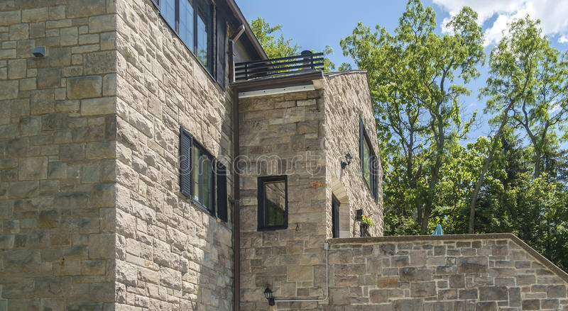 Stone house. Old stone house in Westmount, Quebec, Canada. Westmount is an affluent suburb on the Island of Montreal, in southwestern Quebec, Canada. It is an royalty free stock photo