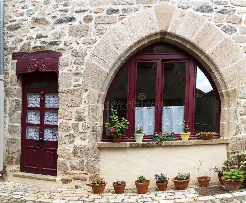 Stone house purpel wood door window stock photography