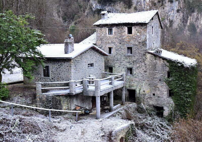 Stone house with a roof covered with frost on the mountainside, along the trada that leads to the lake of Isola Santa, magic in th. E heart of the Apuan Alps, in royalty free stock photo
