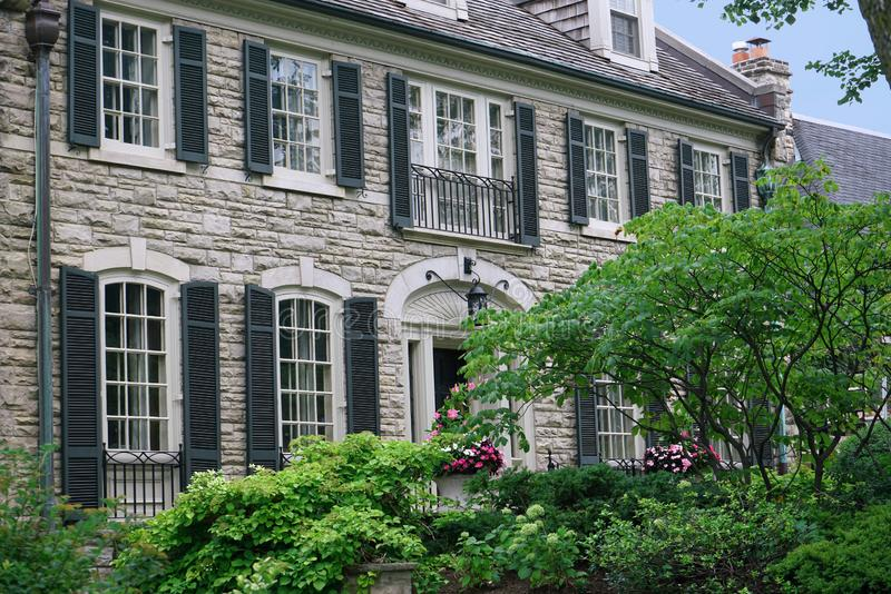 Stone house with shutters stock photos