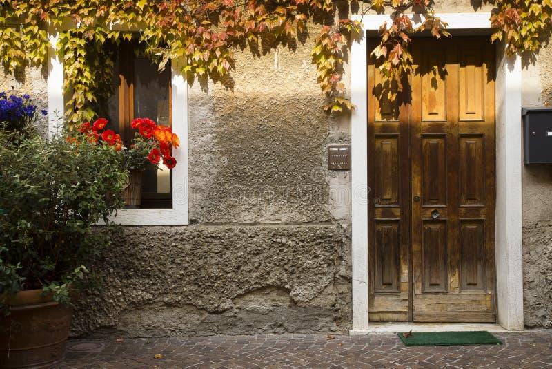 Stone house wood door, Bardolino, Italy stock photography