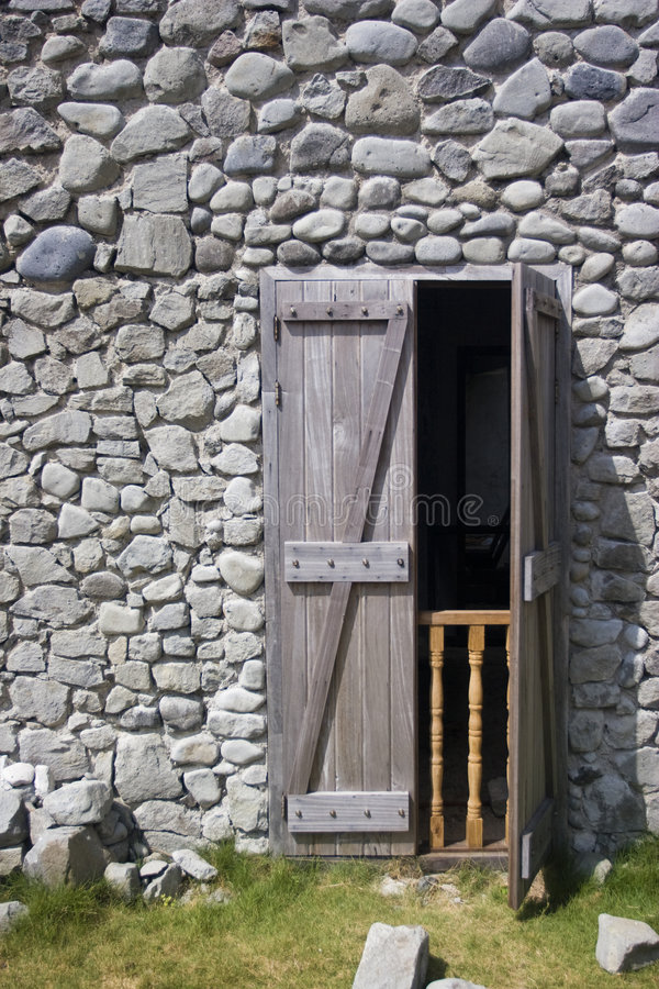Stone House, Wooden Door Royalty Free Stock Image