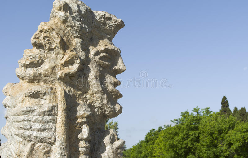 Stone idol. A stone idol seems to speak royalty free stock photo