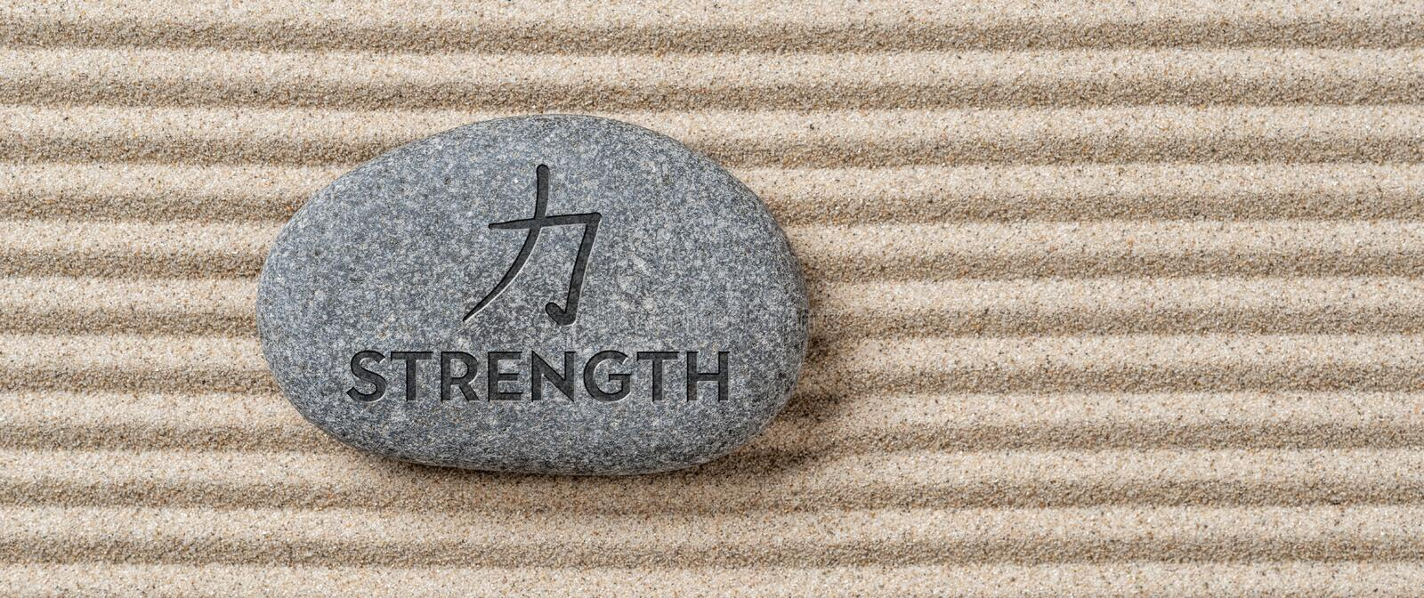 Stone with the inscription Strength stock photo