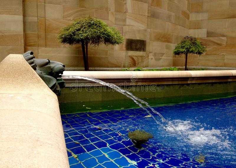 War memorial lion, pool water symbols victory & cleansing ANZAC Square stock photography