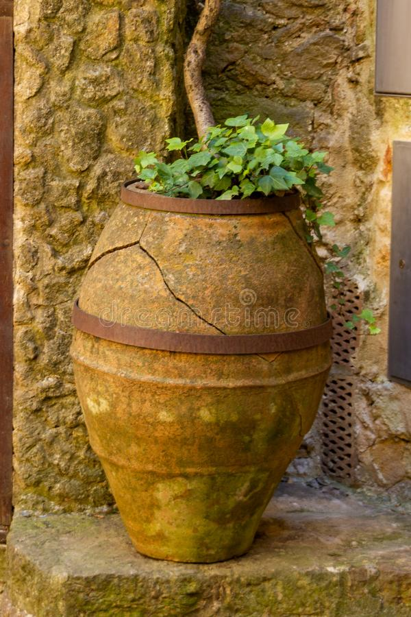 Stone jar in street of Pals stock image