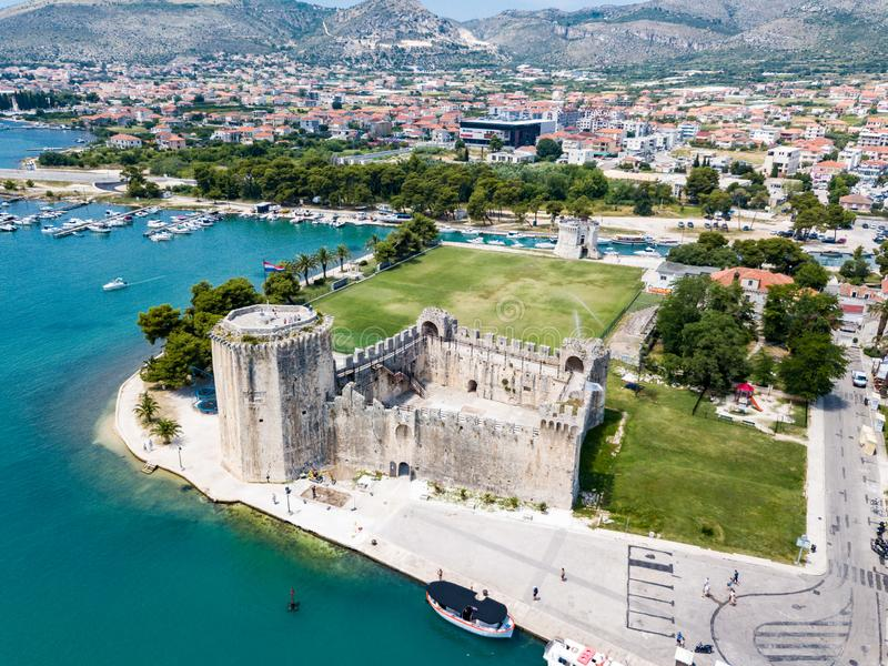 Stone Kamerlengo Castle, medieval city walls and yachts marina. Aerial view of touristic old Trogir, historic town. royalty free stock photo