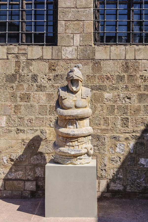 Stone Knight and the Boa constrictor. Ancient Greek artefact of the Archaeological Museum. Rhodes, Greece. stock photography