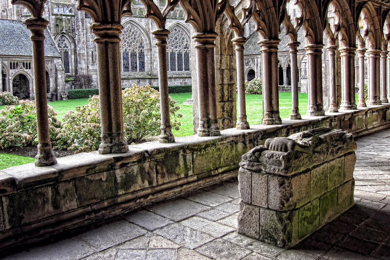 Stone Knight Tomb in Old Gothic Cathedral Cloister. Old carved stone medieval knight tomb inside the fifteenth century gothic style cloister of Saint Tugdual stock photography