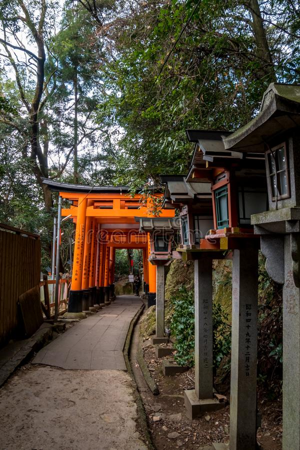 Stone lamps and orange torii royalty free stock images