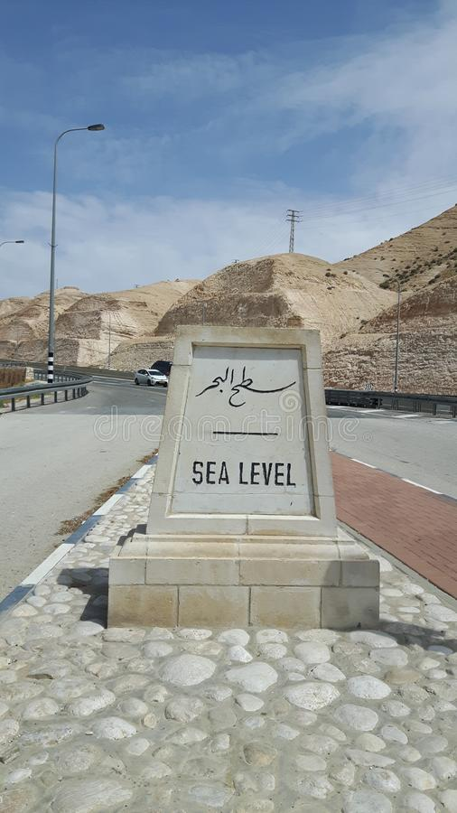 Stone sea level sign on the way to Dead Sea stock photo