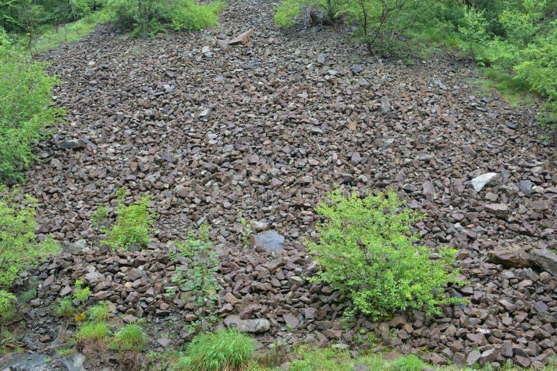 Stone landslide under spring rain, horizontal orientation royalty free stock images