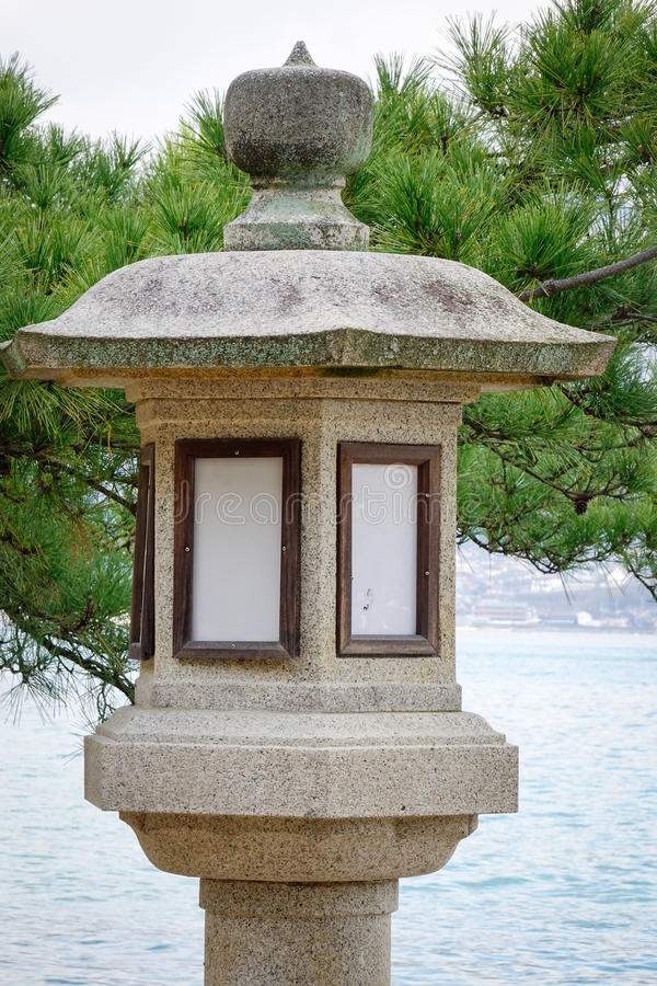 Stone lantern at Miyajima temple in Hiroshima, Japan royalty free stock images