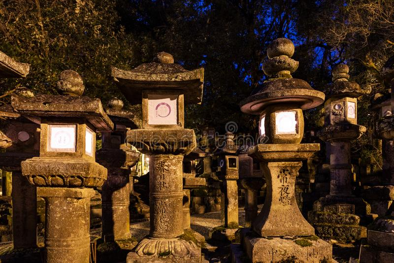 Lighted stone lanterns at night in Kasuga Taisha shrine in Nara, Japan. UNESCO World Heritage Site royalty free stock photos
