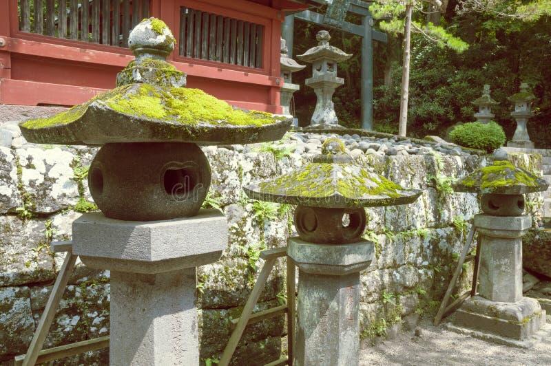 Stone lanterns row royalty free stock photography