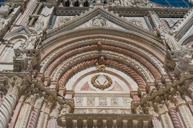 Stone lattice architectural detail of arch at the entrance to Siena Cathedral royalty free stock images