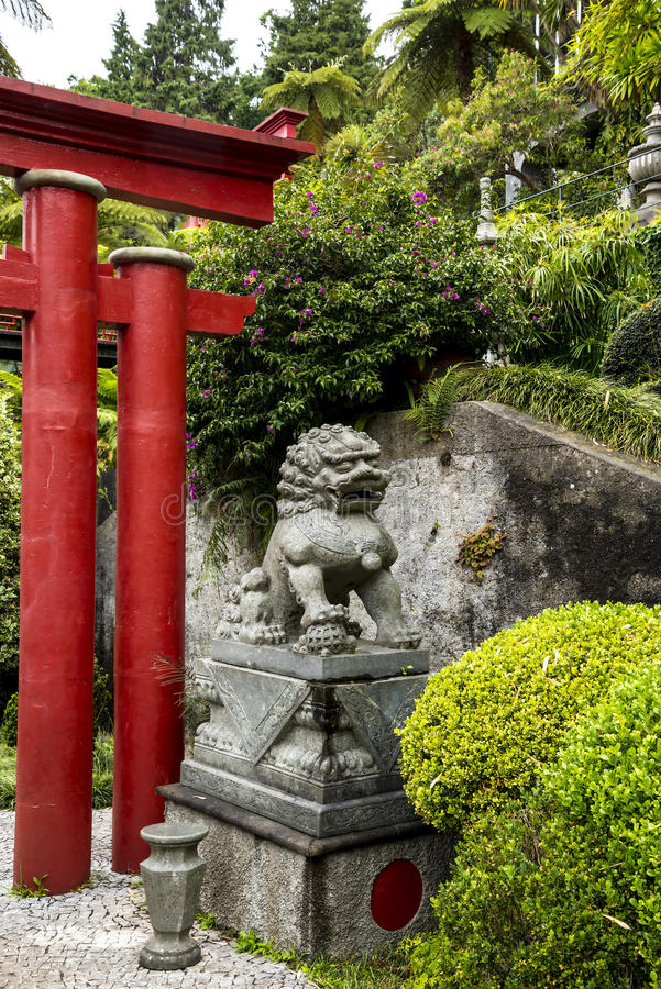 Stone Lion in a Beautiful Garden at Monte above Funchal Madeira. This wonderful garden is at the top of the cablecar from the seafront in Funchal. It is filled royalty free stock images