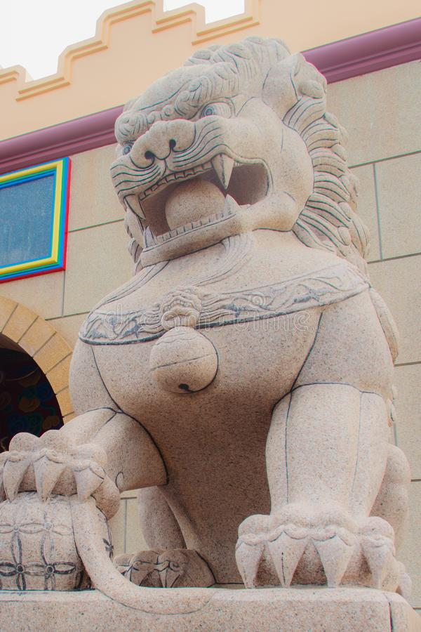 Stone Lion Guardian statue at the entrance gate of Anek Kusala Sala Viharn Sien, Thai-Chinese temple in Pattaya, Thailand. It wa stock images