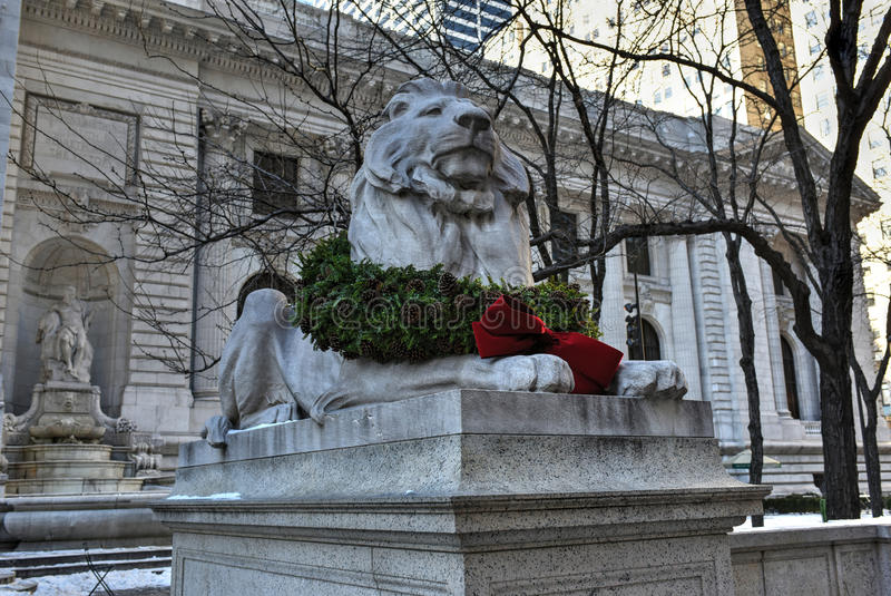 Stone Lion - Midtown Library, New York. Stone lion at the entrance to the New York Public Library Main Branch in Midtown, Manhattan, New York stock image