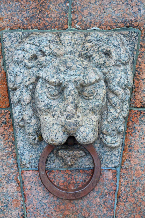 Stone lion's head on Exchange Square on the spit of Vasilyevsky Island in Saint Petersburg, Russia. On Neva river in the centre of Saint Petersburg, Russia stock photo