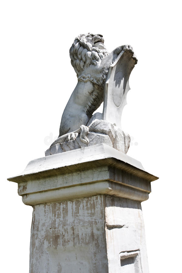 Stone lion statue isolated. Stone lion statue on a pedestal, isolated stock image