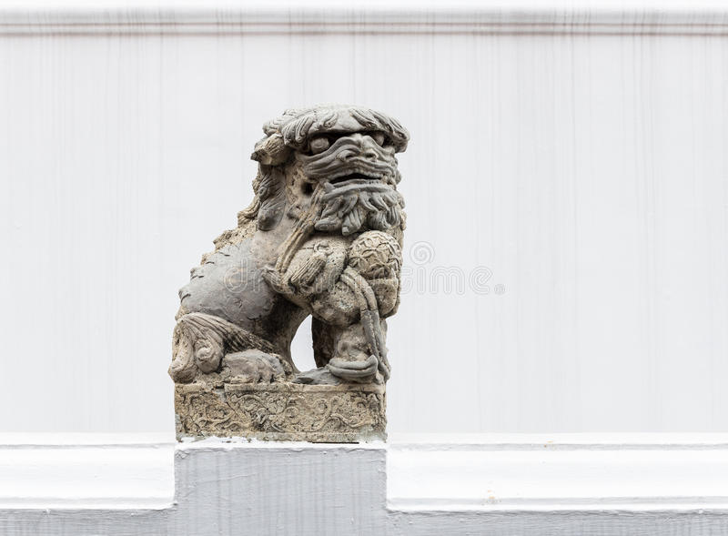 Stone lion statue in the traditional Chinese style. stock photo