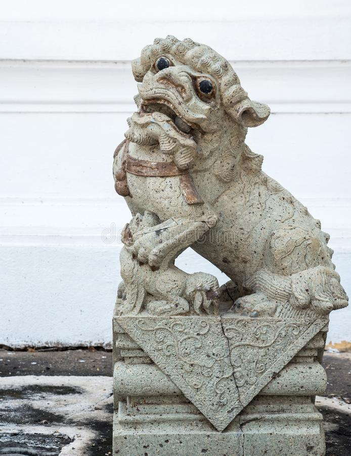 Stone lion statue in the traditional Chinese style. stock image