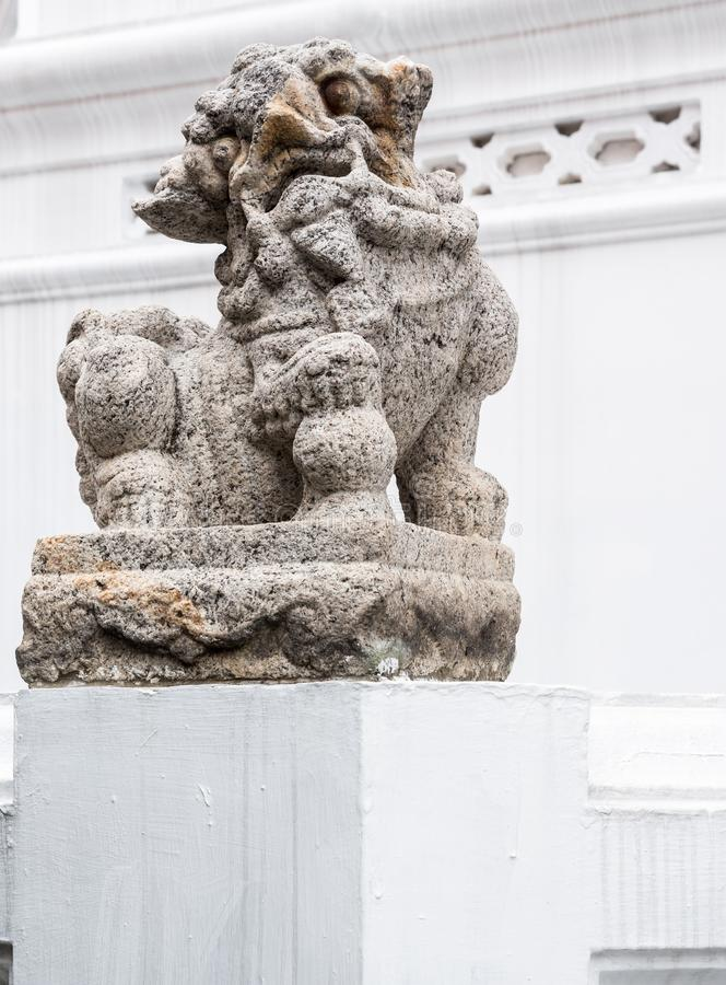 Stone lion statue in the traditional Chinese style royalty free stock photos