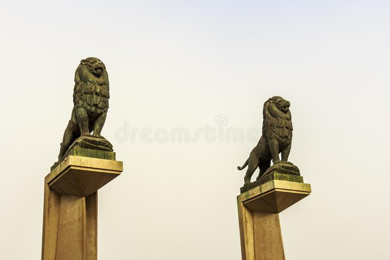 Stone lion statues on pillar guarding the Bridge of Lions royalty free stock image
