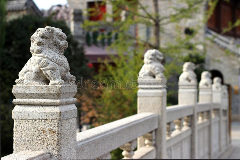 Stone lions on the railings of the bridge royalty free stock photography
