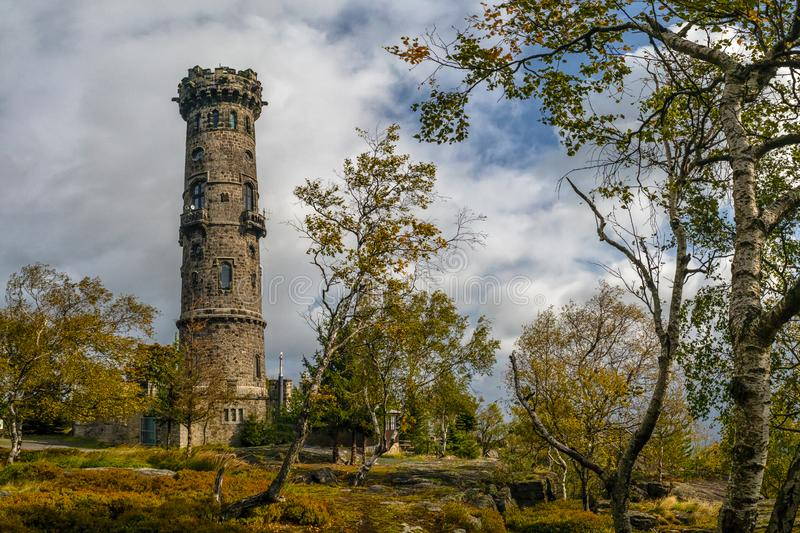 Stone lookout tower on top of mountain The Decinsky Sneznik royalty free stock photos