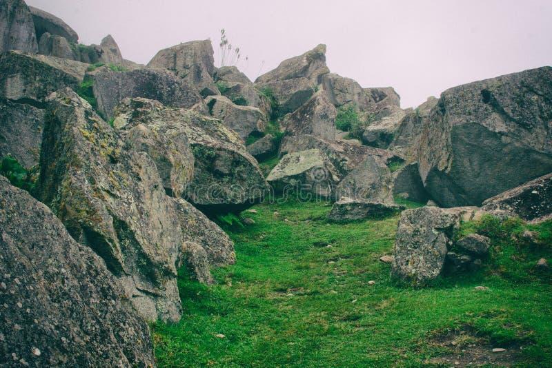 Stone ancient ruins along the Inca Trail to Machu Picchu in Peru. Stone magical ancient ruins along the paved path Inca Trail to Machu Picchu in Peru stock photos